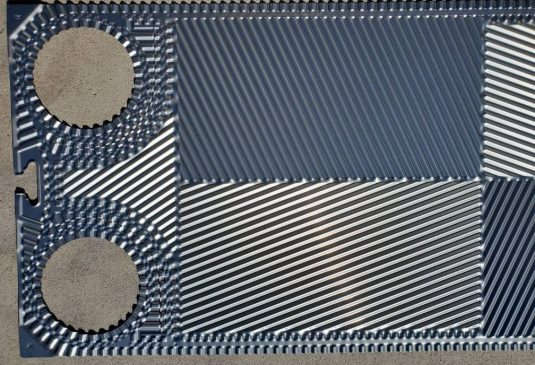 silver metallic colored heat exchanger plate