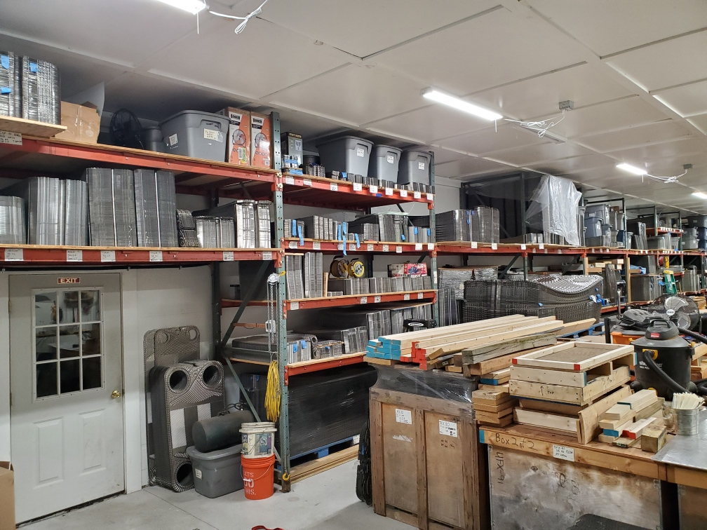 various heat exchanger plates and other parts and components sitting in storage